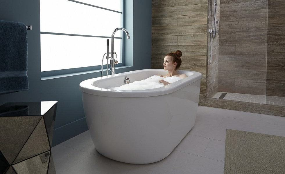 Woman taking a bath in her freestanding bathtub