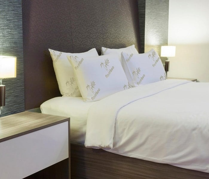 Image of four bamboo pillows on queen-size bed