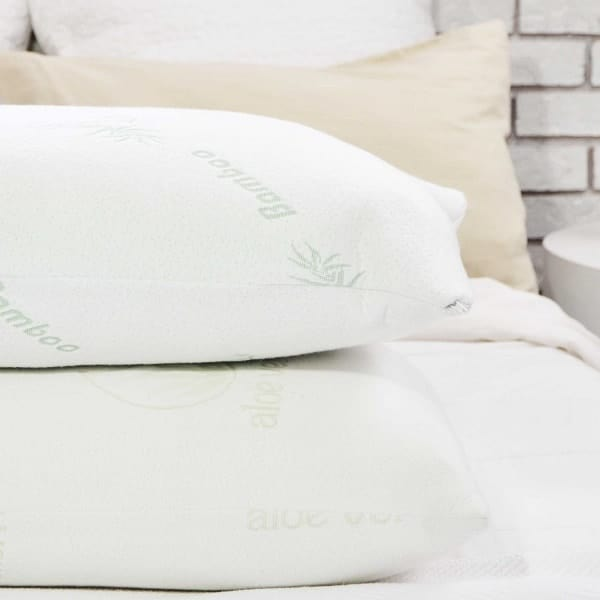 Image of two stacked bamboo pillows on bed