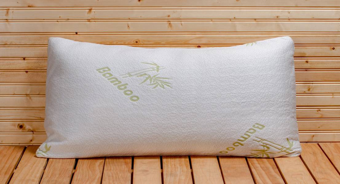 Picture of a bamboo pillow on a wood surface