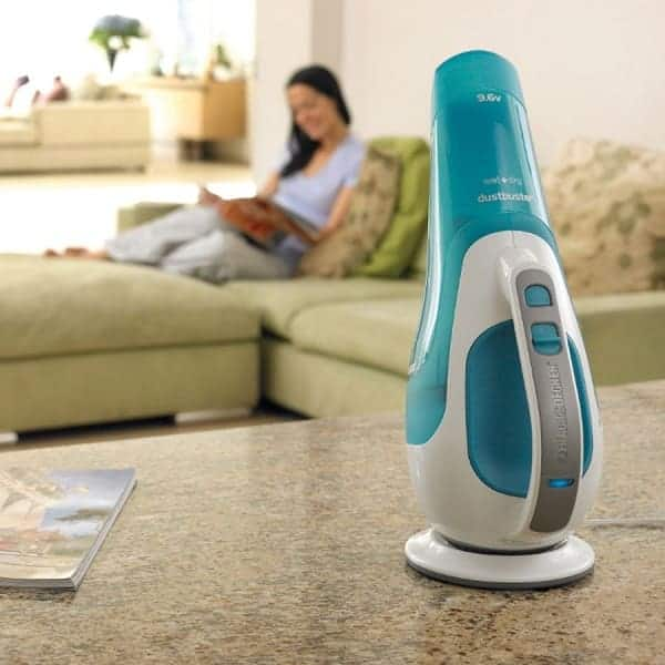 Compact handheld vacuum on the living room table