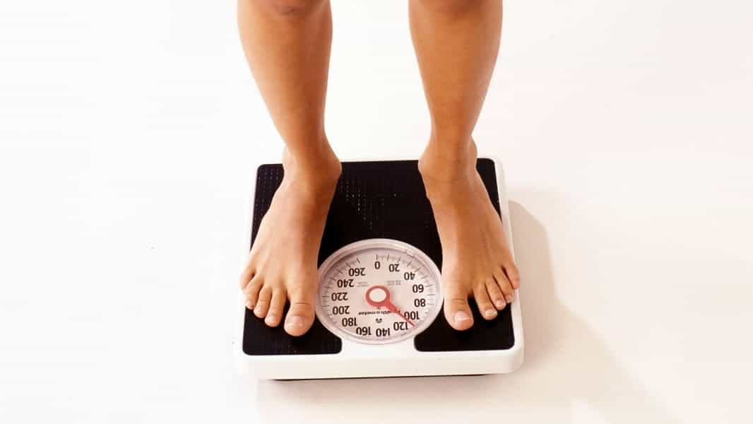 Picture of a woman on a classic scale